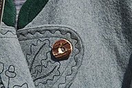 Germany, Close up of traditional jacket with button and embroidery - TCF002891