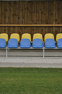 Germany, Bavaria, Munich, Stand with blue and yellow plastic seats - AXF000331