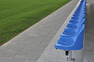Germany, Bavaria, Munich, Stand with blue plastic seats - AXF000333