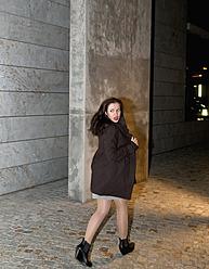 Germany, Berlin, Young woman running through street - BFRF000087