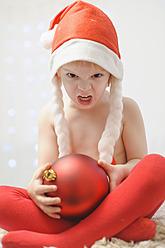 Boy holding christmas bauble - MJF000147