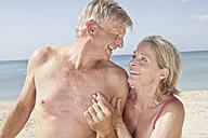 Spain, Mallorca, Happy senior couple at beach - PDYF000267
