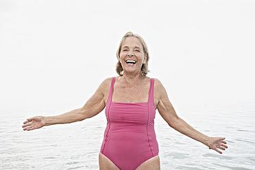 Spain, Senior woman on beach - PDYF000252