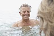 Spain, Senior couple swimming in sea - PDYF000246