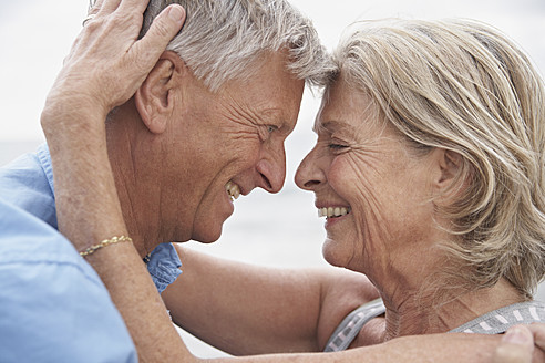 Spain, Senior couple looking at each other, smiling - PDYF000219