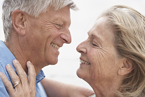Spain, Senior couple looking at each other, smiling - PDYF000216