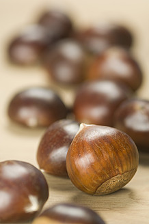 Close up of sweet chestnut on table - ASF004662