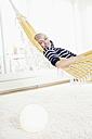 Germany, Bavaria, Munich, Woman relaxing in hammock, portrait - RBYF000224