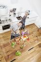 Germany, Bavaria, Munich, Family having fun in kitchen - RBYF000295