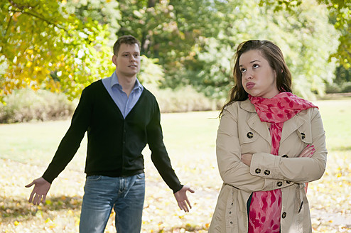 Germany, Berlin, Couple arguing in autumn park - BFRF000124