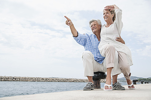 Spain, Senior couple at harbour, smiling - WESTF019046
