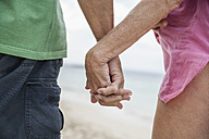 Spain, Seniors couple holding hands, close up - WESTF019082