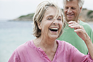 Spain, Senior couple at beach - WESTF019088