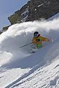 Austria, North Tirol, Mature man skiing - FFF001316