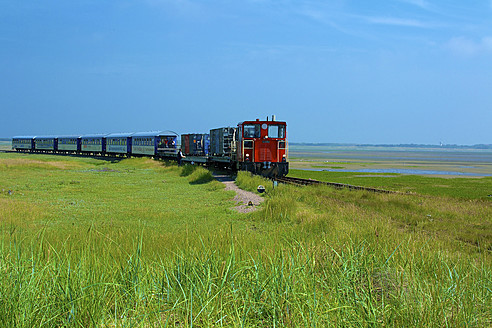 Germany, Lower Saxony, Train passing through Wangerooge - MH000024