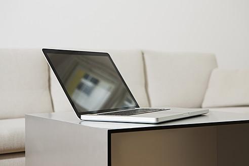 Germany, Berlin, Laptop on living room table - SKF000957