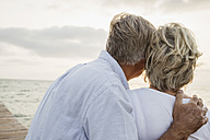 Spain, Senior couple standing at the sea - JKF000017