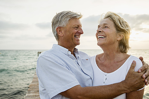 Spain, Senior couple embracing at the sea - JKF000020