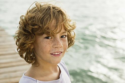 Spain, Portrait of boy at Atlantic Ocean, smiling - JKF000080
