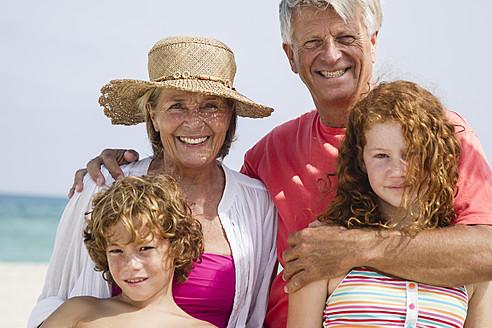 Spain, Grandparents with grandchildren smiling, portrait - JKF000085