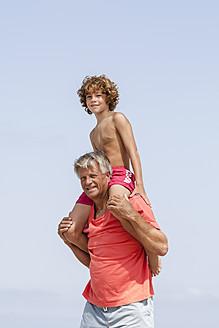Spain, Grandfather carrying grandson on shoulder - JKF000100