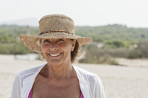 Spain, Senior woman at beach, smiling - JKF000109