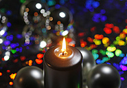 Candlelight in front of luminous colourful background - JTF000234