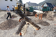 Germany, Rhineland-Palatinate, house building, earth works, laying pipes - CSF015995