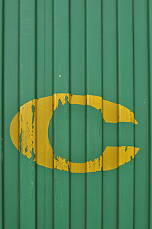 Germany, Yellow coloured letter C on green painted container - AXF000394