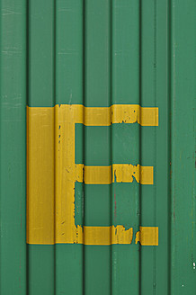Germany, Yellow coloured letter E on green painted container - AXF000392