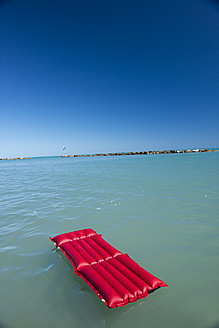 Italy, Air mattress floating on water - KAF000040