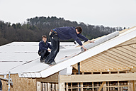 Europe, Germany, Rhineland Palatinate, Workers roofing on house - CSF016096