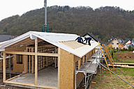 Europe, Germany, Rhineland Palatinate, Workers roofing on house - CSF016099