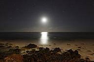 Spain, La Gomera, View from beach of Valle Gran Rey over moonlit sea - SIE003080
