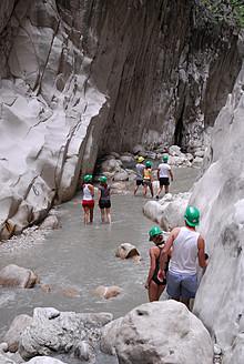 Turkey, Fethiye, Tourist making line in Esen Cayi River gorge at Saklikent Canyon Nature Park - MIZ000050