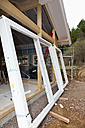Europe, Germany, Rhineland Palatinate, Window frames leaning on prefabricated house - CSF016134