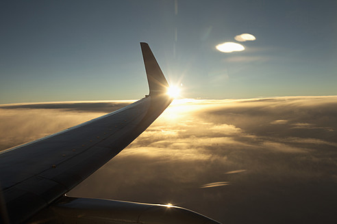 Aeroplane wing above cloud at sunset - DBF000233