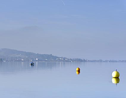 Switzerland, Lachen, Buoys and fishing boat on Lake Zurich - HLF000035