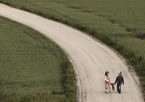Austria, Girl and Boy walking on road with teddy bear - CW000005