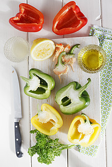 Various bell pepper with olive oil and parsley on table - EVGF000004