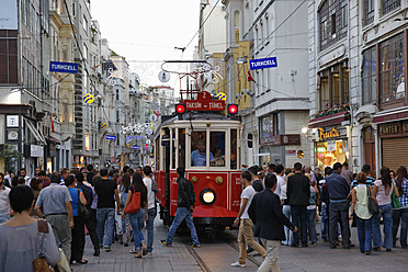 Turkey, Istanbul, People and historical tram on Istiklal Caddesi road - SIE003266