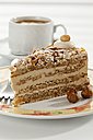 Slice of Noisette Cake with cup of coffee, close up - CSF016333