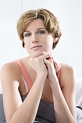 Young woman sitting on couch - MAEF005765