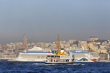 Turkey, Istanbul, View of ferry boat and MS AIDA diva cruise liner on Bosphorus - SIE003306