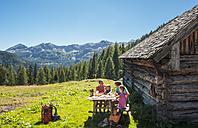 Austria, Salzburg Country, Family having rest at Altenmarkt Zauchensee - HHF004391