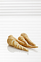Fresh parsnips on white background, close up - CSF016708