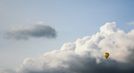Austria, Hot air balloon at Oberhofen against cloudy sky - WVF000298