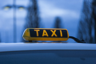 Germany, Bavaria, Munich, Roof of taxi and taxi sign - TCF003304