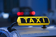 Germany, Bavaria, Munich, Roof of taxi and taxi sign - TCF003305