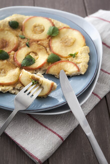Apple and oat flakes pancake with fork and knife - EVGF000055